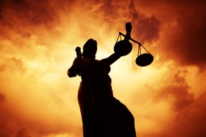 Lady Justice Statue with Sunset Background
