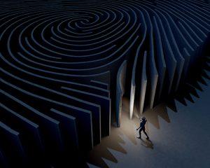 man entering fingerprint maze with flashlight graphic