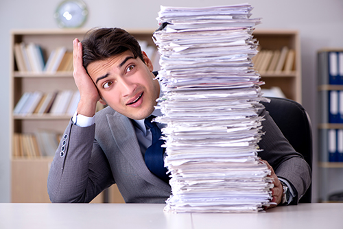 businessman-overwhelmed-paperwork